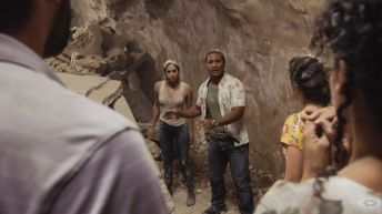 """Kuipeia e ka makani apaa"" -- Tani and Junior must plot an escape for themselves and several civilians after they become trapped inside a deadly tunnel collapse, while Five-0 investigates the cause and culprits of the cave-in. Also, Eddie the dog uses his field experience and sniffs out a bomb that has been planted in McGarrett's home, on HAWAII FIVE-0, Friday, Oct. 4 (8:00-9:00 PM, ET/PT) on the CBS Television Network. Pictured L to R: Meaghan Rath as Tani Rey and Beulah Koale as Junior Reigns. Photo: screengrab/CBS ©2019 CBS Broadcasting, Inc. All Rights Reserved (""Kuipeia e ka makani apaa"" is Hawaiian for ""Knocked flat by the wind; sudden disaster"")"